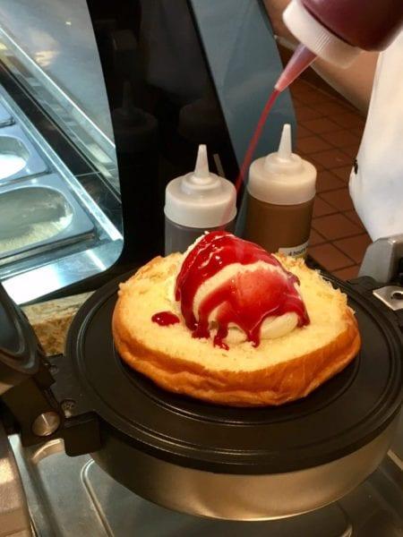 L'Artisan des Glaces Review putting sauce on brioche ice cream sandwich