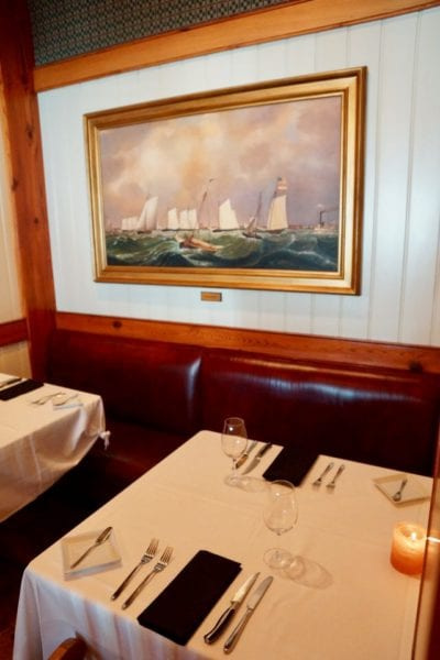 Yachtsman Steakhouse Full Review booth with yacht painting