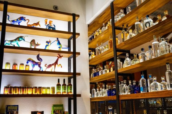 Frontera Cocina Review Tequila Shelves and Figurines