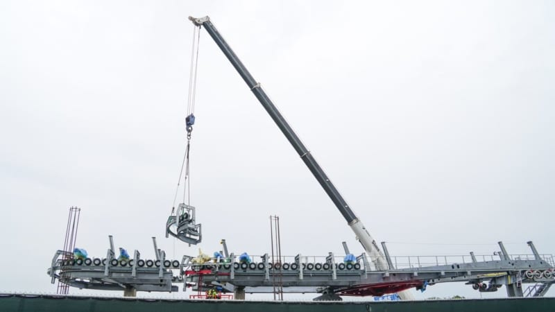 crane lifting piece into place for Disney Skyliner Landing System Installation at Hollywood Studios