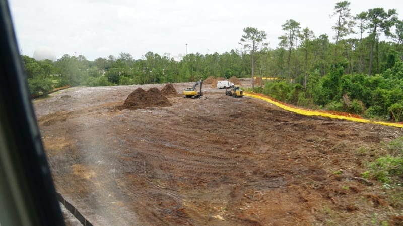 Land Clearing for Epcot Hotel Support Area Started construction trucks