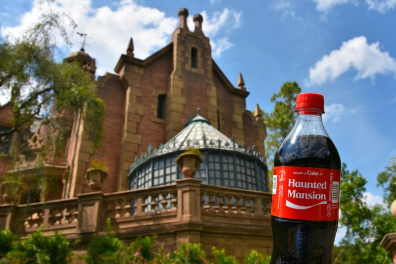 New Attraction-Based Coke Bottles Arrive in Disney Parks haunted mansion