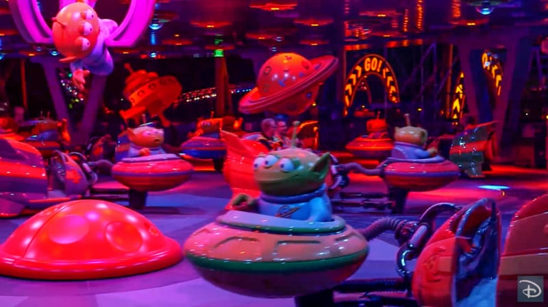 Nighttime Preview of Toy Story Land alien swirling saucers inside